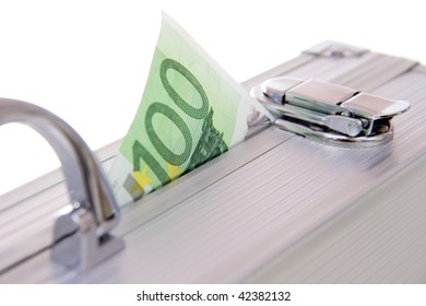 one hundred euro banknote sticking out of an aluminum suitcase isolated on white