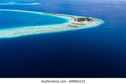 one of hundred islands in maldives watched from the seaplane