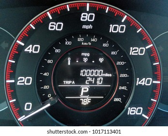 One hundred thousand miles on car odometer display