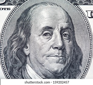 One hundred US dollar bill fragment with Benjamin Franklin portrait