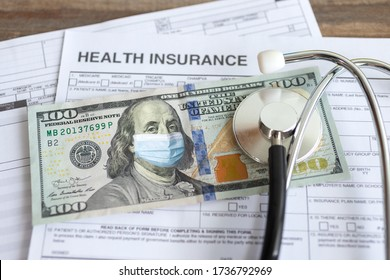 One hundred us dollar with face mask on insurance paper bill. Health care cost during coronavirus covid outbreak concept