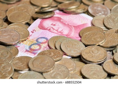 One hundred yuans on heap of old coins