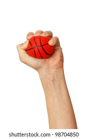 one isolated hand squeezes small sponge basketball toy ball over white background