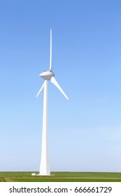 One isolated wind turbine in flat Dutch land, clean energy production in Emmeloord, Netherlands