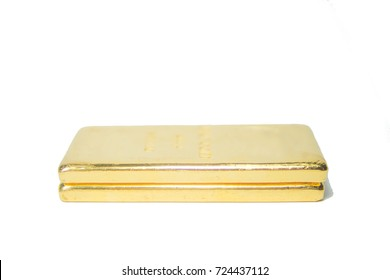 one kilogram fine gold bullion bar. isolated white background. Detail side shot with low depth of field.