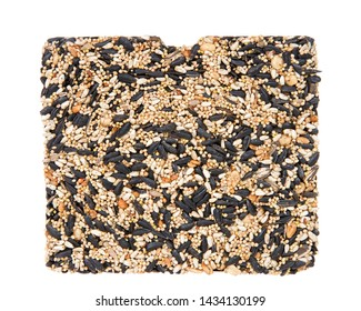 One large bird seed cake for bird feeder. A specialty treat that birds love, popular for wire basket bird feeders. sunflowers, peanuts, safflower, millet and honey to form a sold cake of bird seed