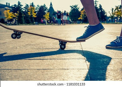 one leg standing on skateboard