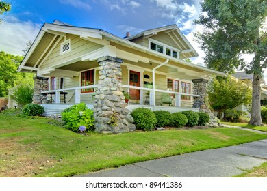 One level medium size green old charming house.