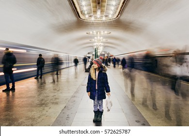 One life as one trip on the subway. All passengers - the people in your life.Who will ride with you to the last stop?Motion blur subway and people waiting at subway station.Girl is standing on station