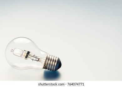 One light bulb on bright background with copy space