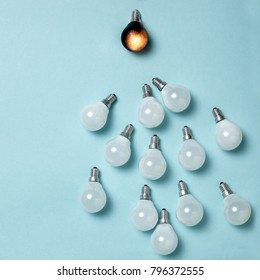 One light bulb outstanding, glowing different. Business creativity idea concepts.