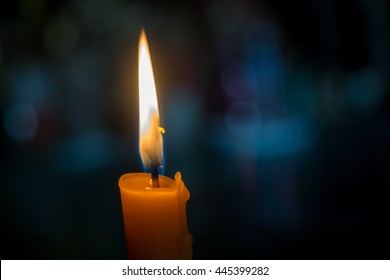 One light candle burning brightly with bokeh background