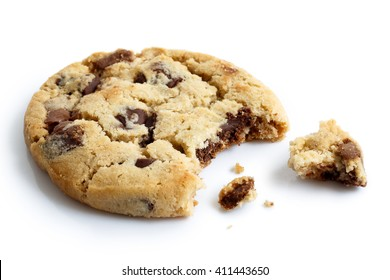 One light chocolate chip cookie, bite missing with crumbs, isolated.