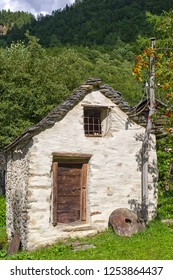 One little cabin, named Rustico, typical for the region Ticino, Tessin, Swiss Alps.