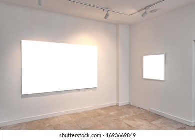 one little white empty frame and one big blank canvas at exhibition
