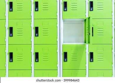 One locker open.Green locker.Green background.Different background concept.