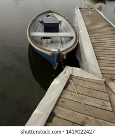 one lonley boat  by the dock outside stockholm