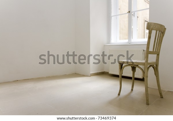 one lonley chair in a apartment which seemed to be abandoned.