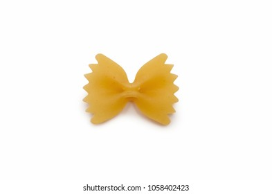 One macaroni in the form of bows - farfalle, isolated on white background
