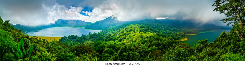 One of the main popular attractions of tropical island Bali visited daily by hundreds of tourists from around the world for look amazing scenic top view, two lakes Batur and Batur volcano / Indonesia