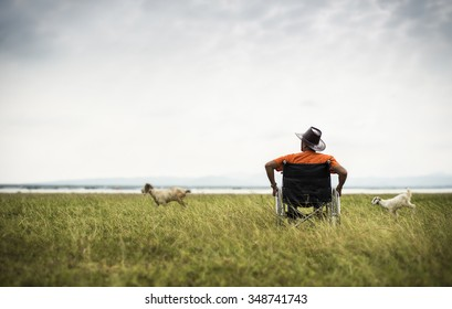 One man alone sitting in a wheel chair
