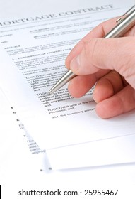 One man is examining mortgage contract for sale of real estate property