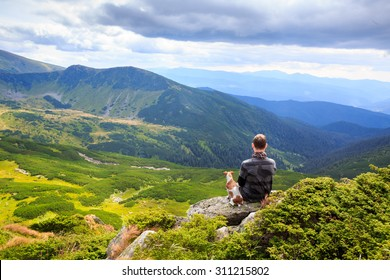 one man and loyal friend dog watching the beautiful pensive dreamy magical mountain landscape. Time for reflection. Harmony with yourself.. Series of photos