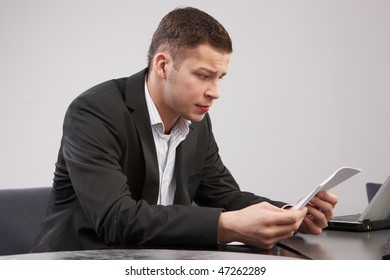 one man in the office reading