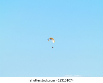 One man practicing extreme sport with paraglider with motor