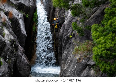 One man rappelling the Arado Waterfall (cascata do arado) in the Peneda Geres National Park, in Portugal.