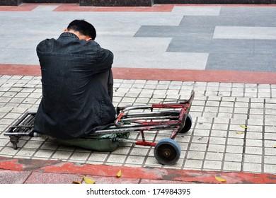 One man sit alone on pedestal look like weary so much.