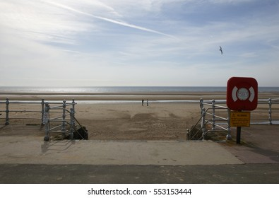 ONE MAN TAKING PHOTOGRAPH OF ANOTHER MAN ON BLACKPOOL BEACH ENGLAND