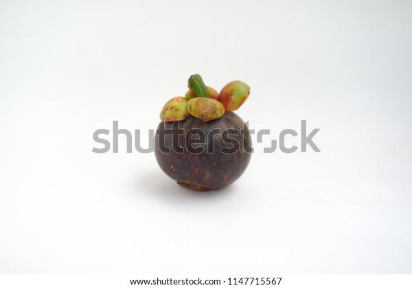 one mangosteen on white background