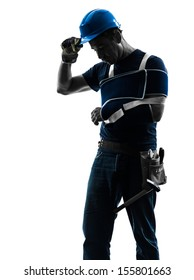 one  manual worker man with injury brace in silhouette on white background