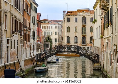 one of the many canals, bridge and typical house architecture style of Venice, Italy