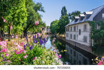 One of the many canals that run through the Petite France district and the Alsace regions. - Shutterstock ID 707250055