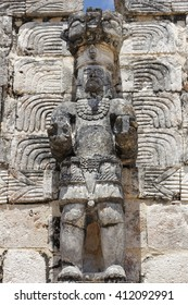 One of the many statues, possibly depicting a god, situated on the facade of a building in the ruins of the Mayan city of Uxmal, Mexico