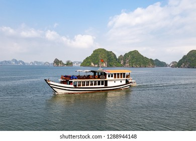 One of the many tour boats sailing among the karst formations in Halong Bay, Vietnam, in the gulf of Tonkin. Halong Bay is a UNESCO World Heritage Site and the most popular tourist spot in Vietnam