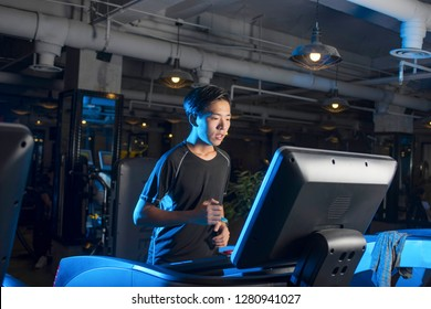 One men exercising on treadmill in gym.