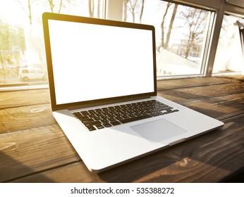 One modern laptop on hte window-sill