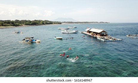 One of the most popular tourist destination in Banyuwangi you should visit is Bangsring Underwater in Tabuhan Island.  - Shutterstock ID 1616148967