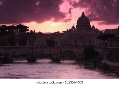 One of the most romantic views of Rome. The sunset over the St. Peter's Basilica in Vatican seen from the Tiber river. All the people who passing by the bridges stop for the spectacular view.