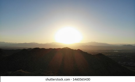 One mountain in the McDowell mountain regional park, in Arizona, during the sunrise, with the sun in the center of the image