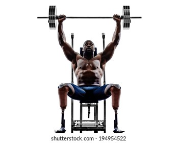 one muscular handicapped man body builders building weights with legs prosthesis in silhouette on white background