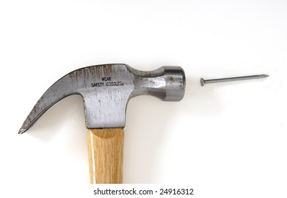 One Nail and a metal hammer with wood handle on a white background.