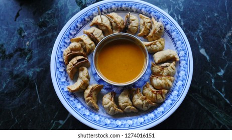 One of Nepal's best food selections is the Mo:mo. They come in a variety of ways. These are fried 'Kothey mo:mo.'