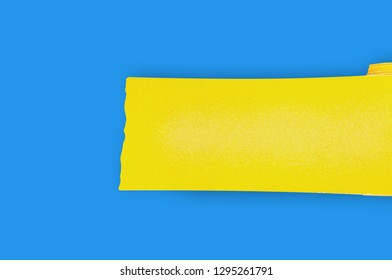 One new roll of yellow abrasive sandpaper for grid wood or metal items on blue table in workshop. Copy space for your text. Top view. Building or repair concept