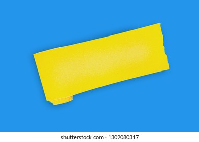 One new roll of yellow abrasive sandpaper for grid wood or metal items in center of blue table in workshop. Top view. Building or repair concept