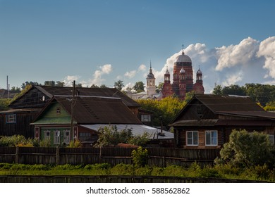 One old church over Russian village against a beautiful sky. Urshum