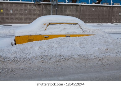 One of the old models of Lada cars of the 70th years of release. This car is forgotten by the owner on the winter road.